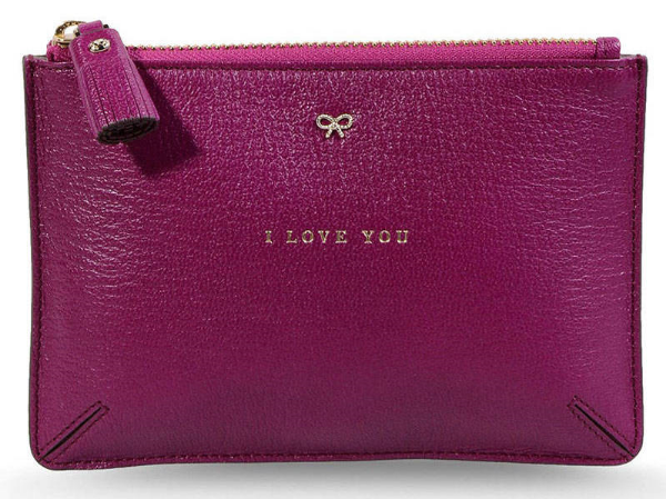 "This  Anya Hindmarch I Love You Pouch  is a leather pouch inscribed with a gold-tone ""I Love You"" on the front and a jewel detail."