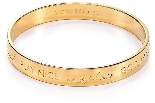 "This  Kate Spade New York Mom Said So Idiom Bangle  is a rhodium-plated or 12k gold–plated metal bangle.  The outer engravings are: ""go play outside,"" ""sit up straight,"" ""say thank you,"" ""do your homework,"" ""play nice,"" and ""say please"", and ""mom said so"" is engraved on the inside."