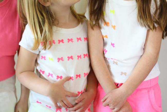 This  DIY Neon Bow T-Shirt For Girls  from Four Flights of Fancy is absolutely adorable. This Bow T-Shirt is easy as this, use a bow stamp and neon color fabric paint, and you too can create an allover Bow printed T-Shirt for your little Princess (just make sure to use masking tape as a line guide to keep your bows straight).