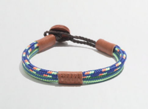 This J.Crew FACTORY BOYS' CORD AND LEATHER BRACELET ($10.00) is in cotton with leather button and trim.