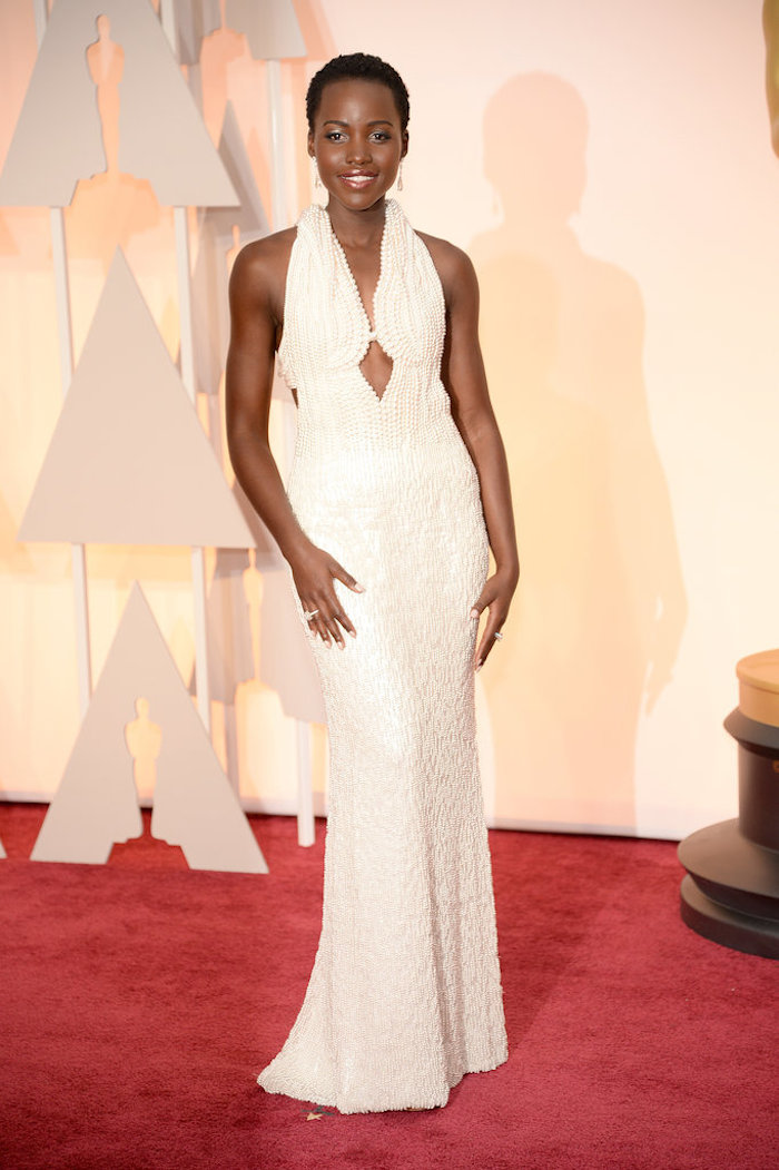 Lupita Nyong'o in a custom gown by Calvin Klein -  hand-sewn with 6,000 pearls of varying sizes