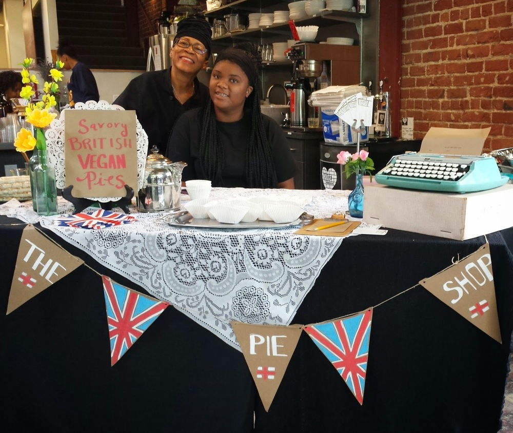 Ebonie of The Pie Shop and Cynthia from Toliver Works smile for the camera.