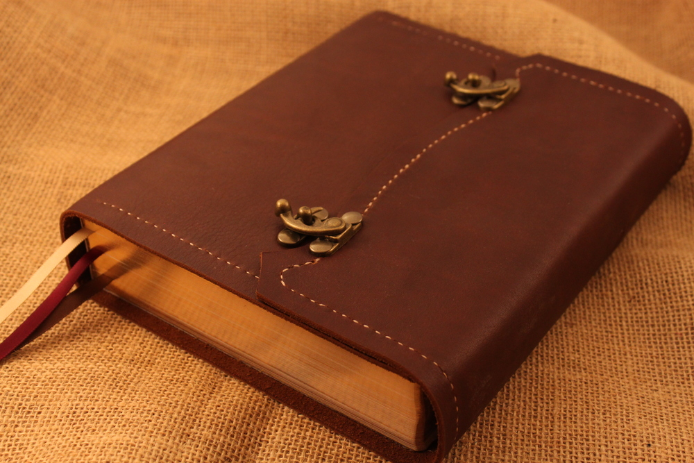 Beautiful dark brown leather cover with a reddish hue