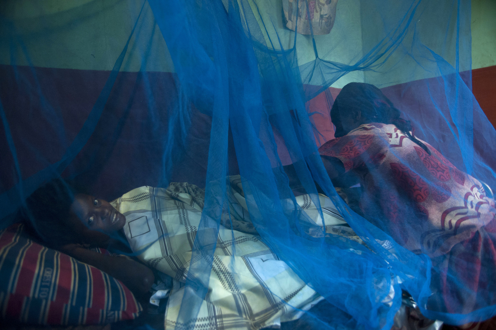 A nurse tends to a women who has just given birth, Bujagali , Uganda.
