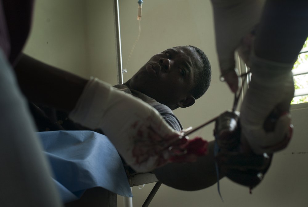 Fixing a machete wound,  Paraiso, Dominican Republic.