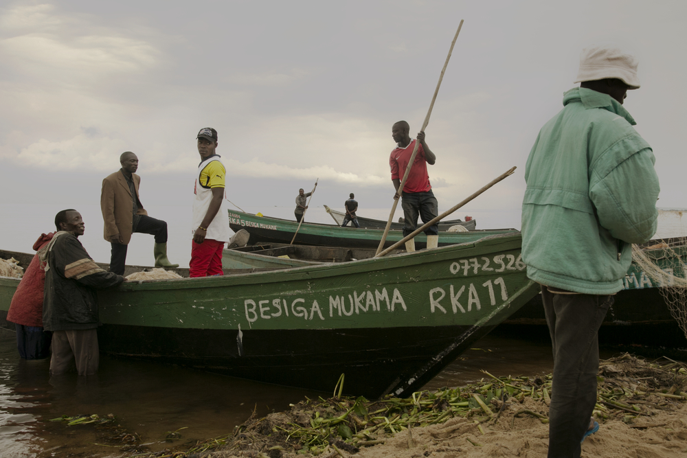 "Crews tend to Kaymba John's boats.   Besiege Mukama  means ""Those Who Believe in God."""