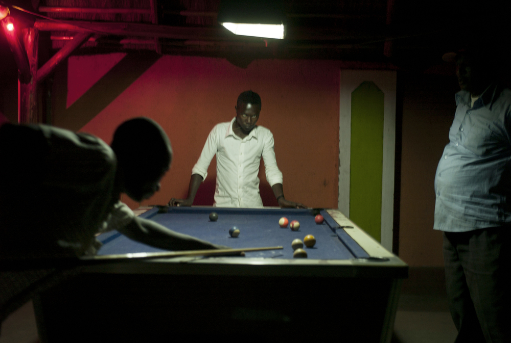 Shooting pool at the New Mugambe Hotel.
