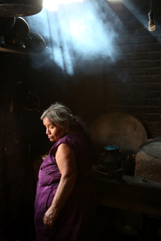 Teresa Raymundo cooks stew at her home in  San Juan del Rio, Oaxaca.