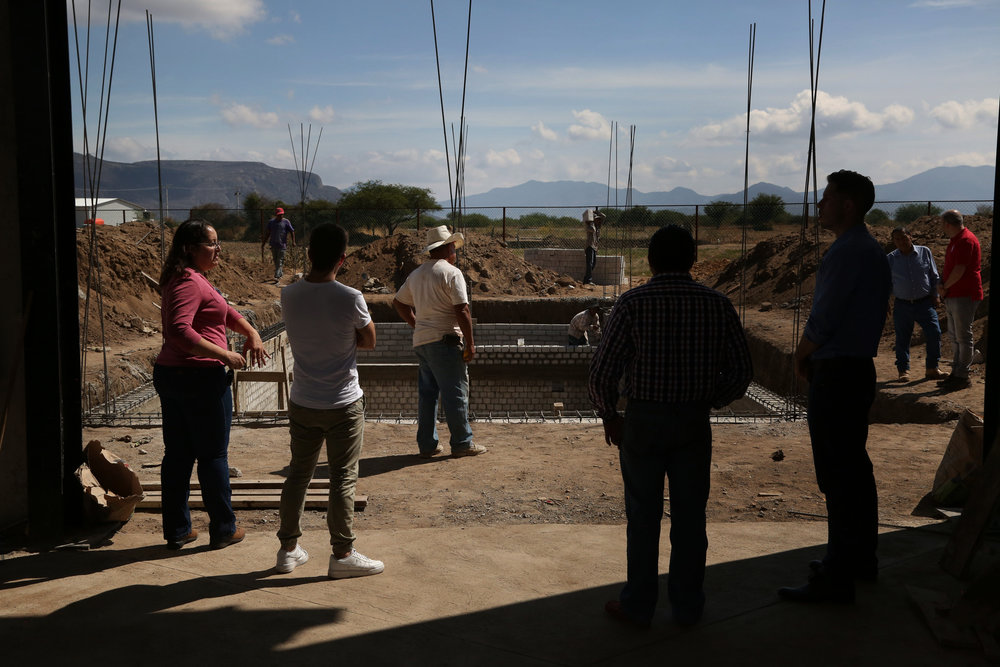A team from Mezcal Amores tours the construction of a new facility for research and production of their Verde line in  Tlacolula, Oaxaca.