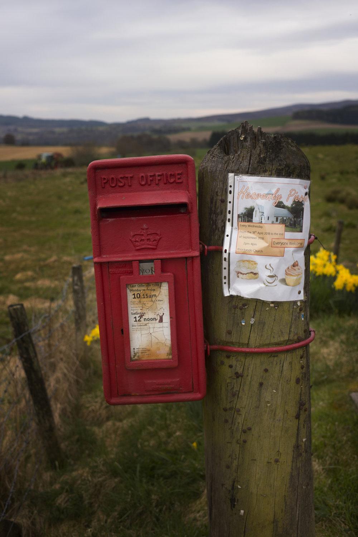 A post box in a field in Cardow.