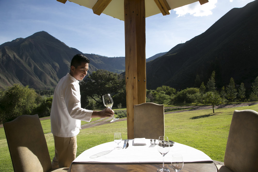 A waiter sets the table at Inkaterra's Hacienda Urubamba.