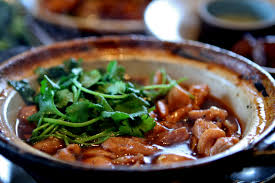 Lemongrass Chicken Clay pot.  Chicken cubes are marinated then simmered in a clay pot with lemongrass and caramel sauce for a rich and flavorful taste.