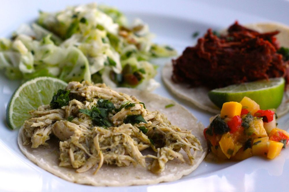chicken and beef tacos with red and green chile sauce