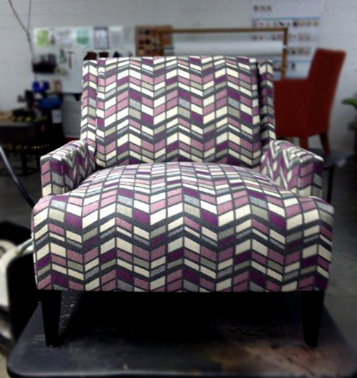 Great treat for a gloomy Monday morning - got to see High Rise in color Seagram upholstered on HBF's Perfect Pitch chair in our plant. So excited to see my pattern work so well on our furniture!