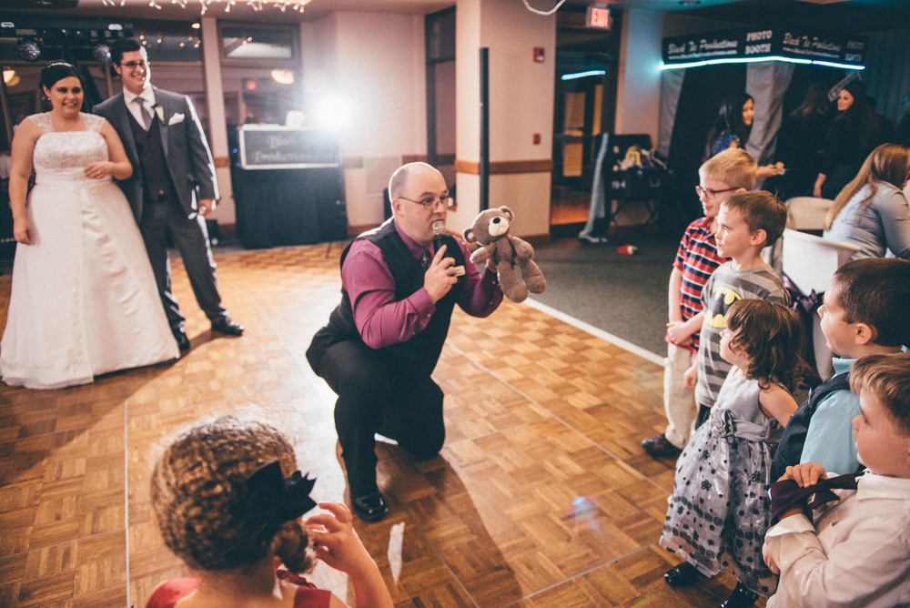 The excellent DJ Anthony Coggins from Black Tie Prodcutions I had the pleasure of working with getting the children excited with the Teddy Bear Toss at Valerie and Kevin's wedding at the Lapeer Country Club.