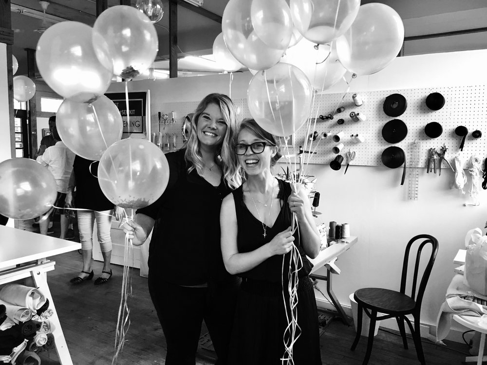 Owner/ Designer Kit Hunzinger (Right) with her Assistant Casey Hasselkus (Left) setting up the final details for the Grand Opening. <3