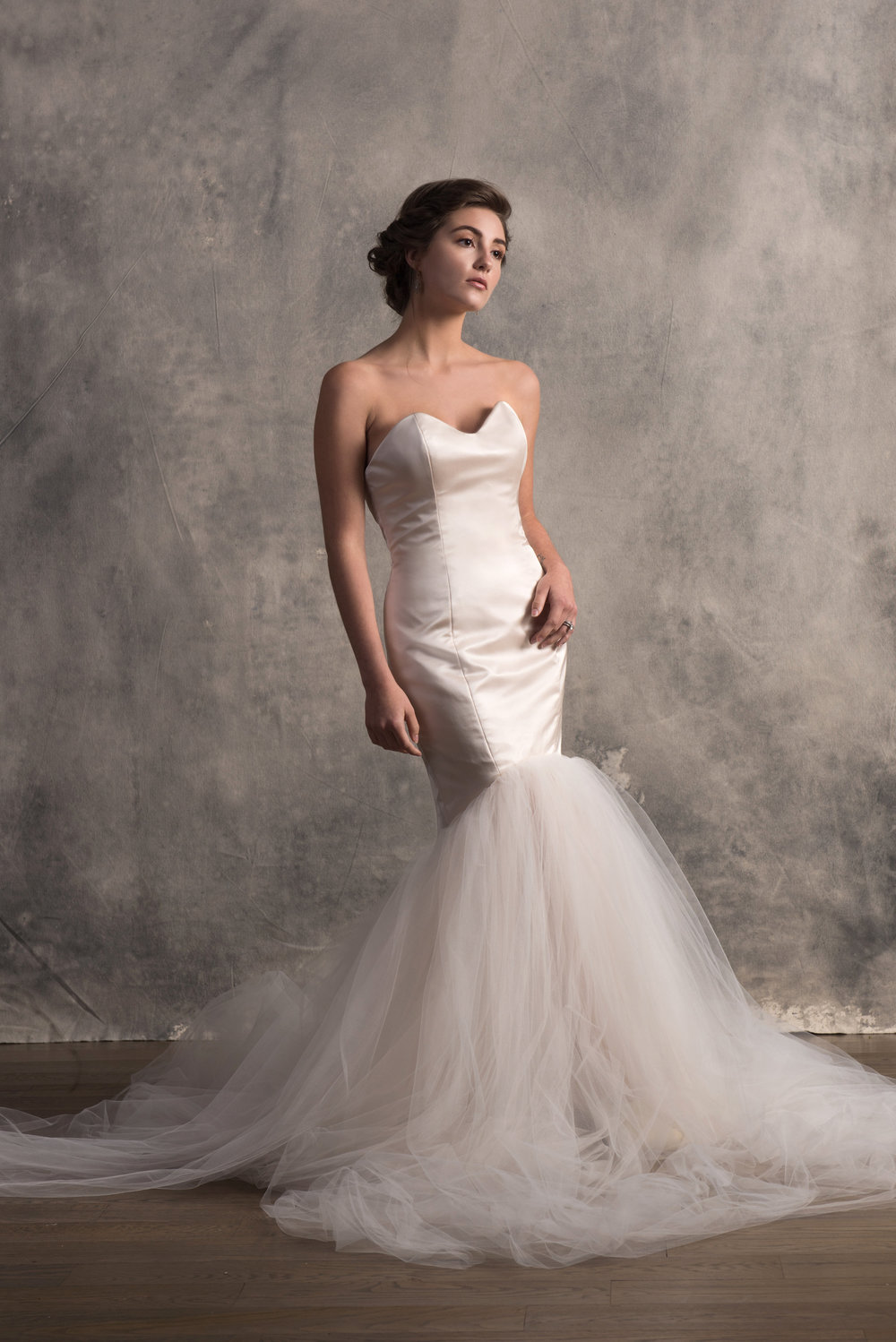 Atla - Silk Duchess- Satin frames the figure, bracing for the frothy cascade of tulle in this mermaid gown. It comes with little surprise that this Goddess was the woman of the freeing water. She's soft and elegant and timeless.