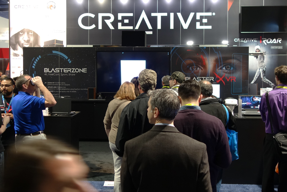 People Streaming in at the Creative Labs booth