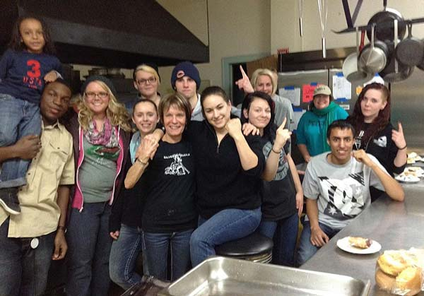 Believers' Boxing volunteering at a local soup kitchen.