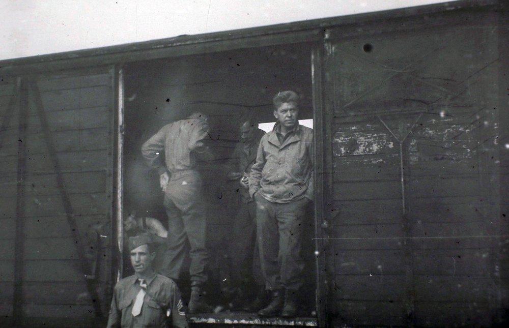 My grandpa Ralph, World War II. He's the cool one standing in the doorway.