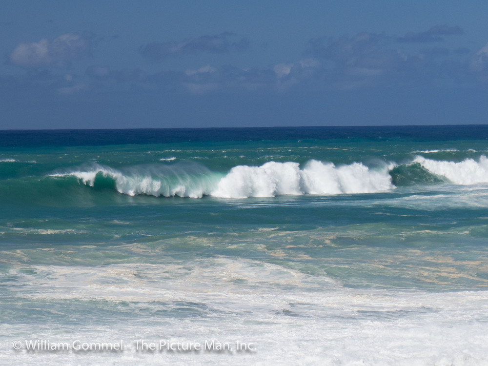 This image was from the area known as Pipeline and the lens does not do justice to the size of the wave.