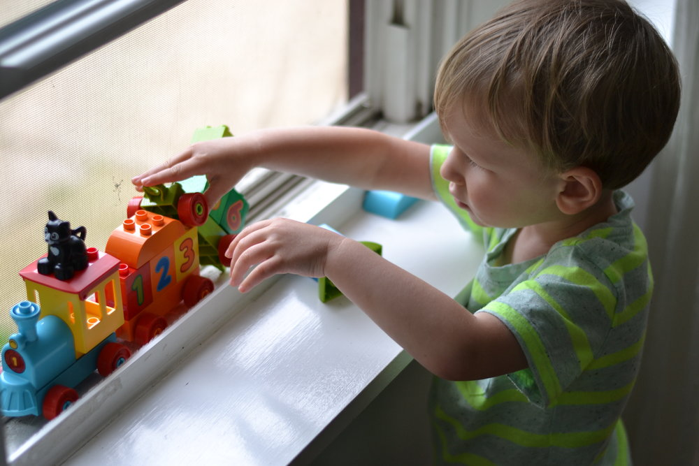 Theo loves trains, and lately he's been using the window track as a train track.