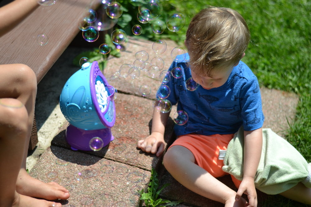 Theo enjoyed his new bubble machine with his cousins.