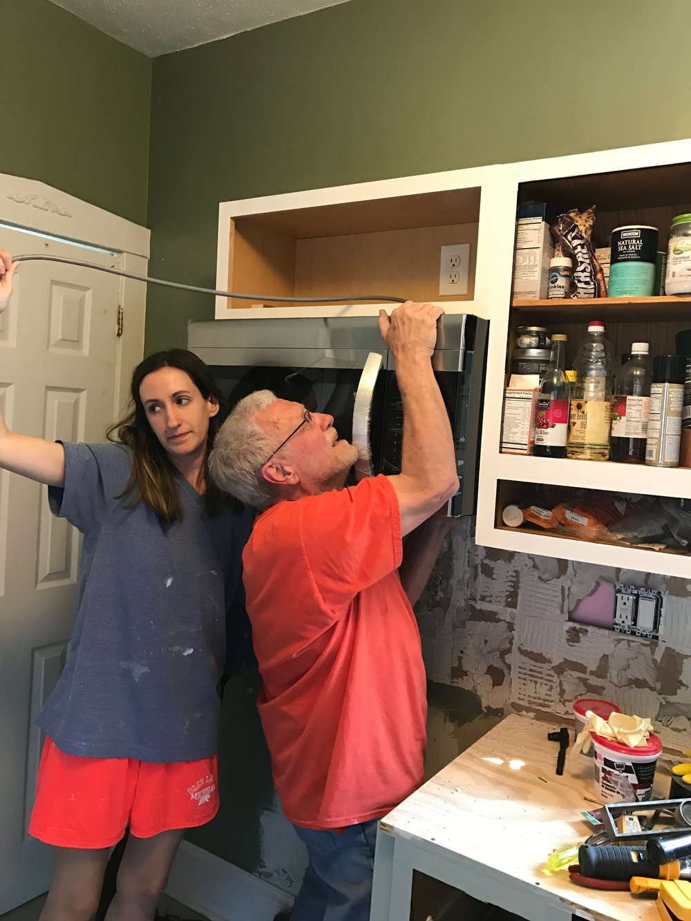 Me helping my dad install this microwave but he is likely doing all the work/lifting