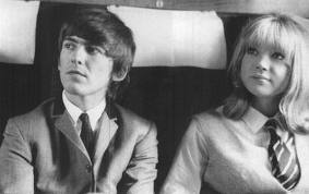 """George with Patty Boyd, the girl who would later be his wife on the set of """"A Hard Day's Night""""."""