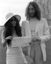 """John and Yoko """"in Gibraltar, near Spain"""" with the marriage license."""