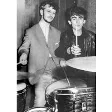 Ringo with a little help from his new friend George Harrison in Hamburg, Germany in 1960. Just John found Paul and Paul found George, George would persuade the others to invite Ringo to join the Beatles.