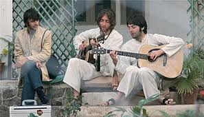 Ringo looks on as John and Paul work through new songs in Rishikesh, India