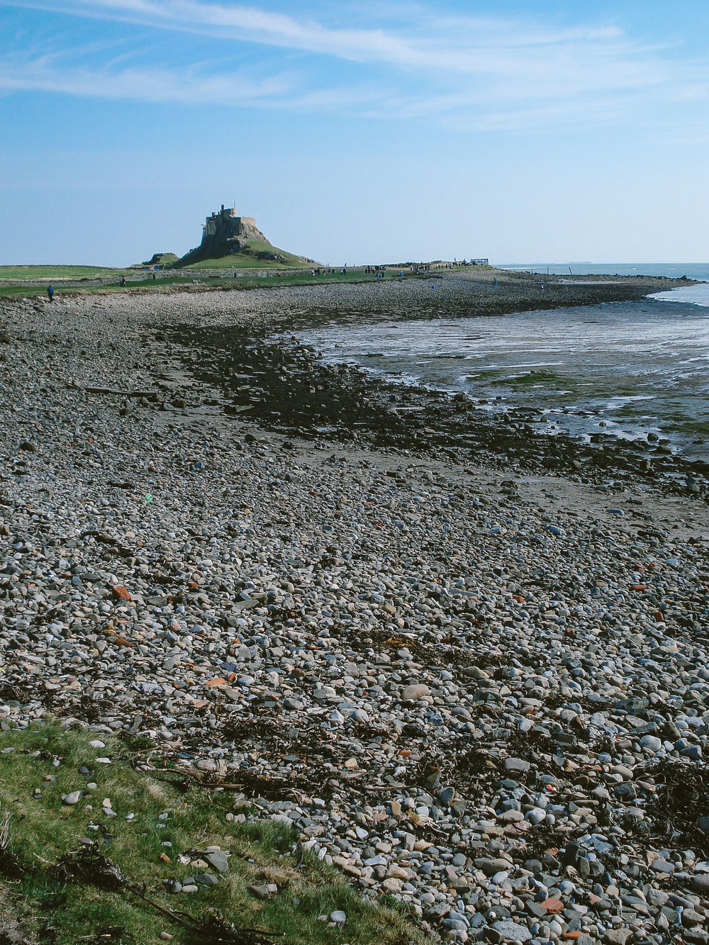 The classic view of Lindisfarne Castle from the beach