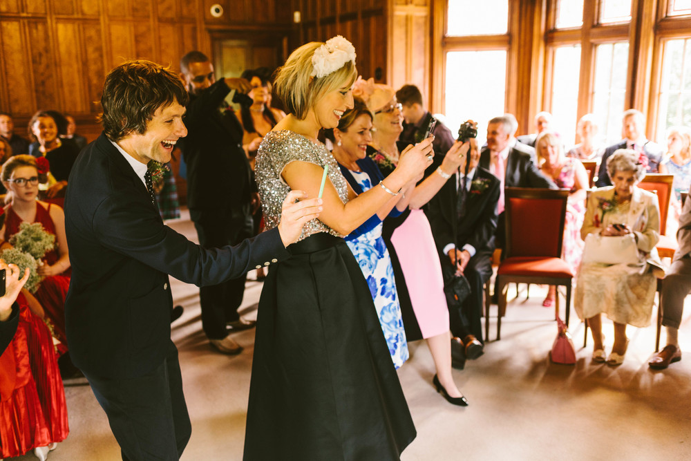 Wedding guests taking photographs at a recent wedding