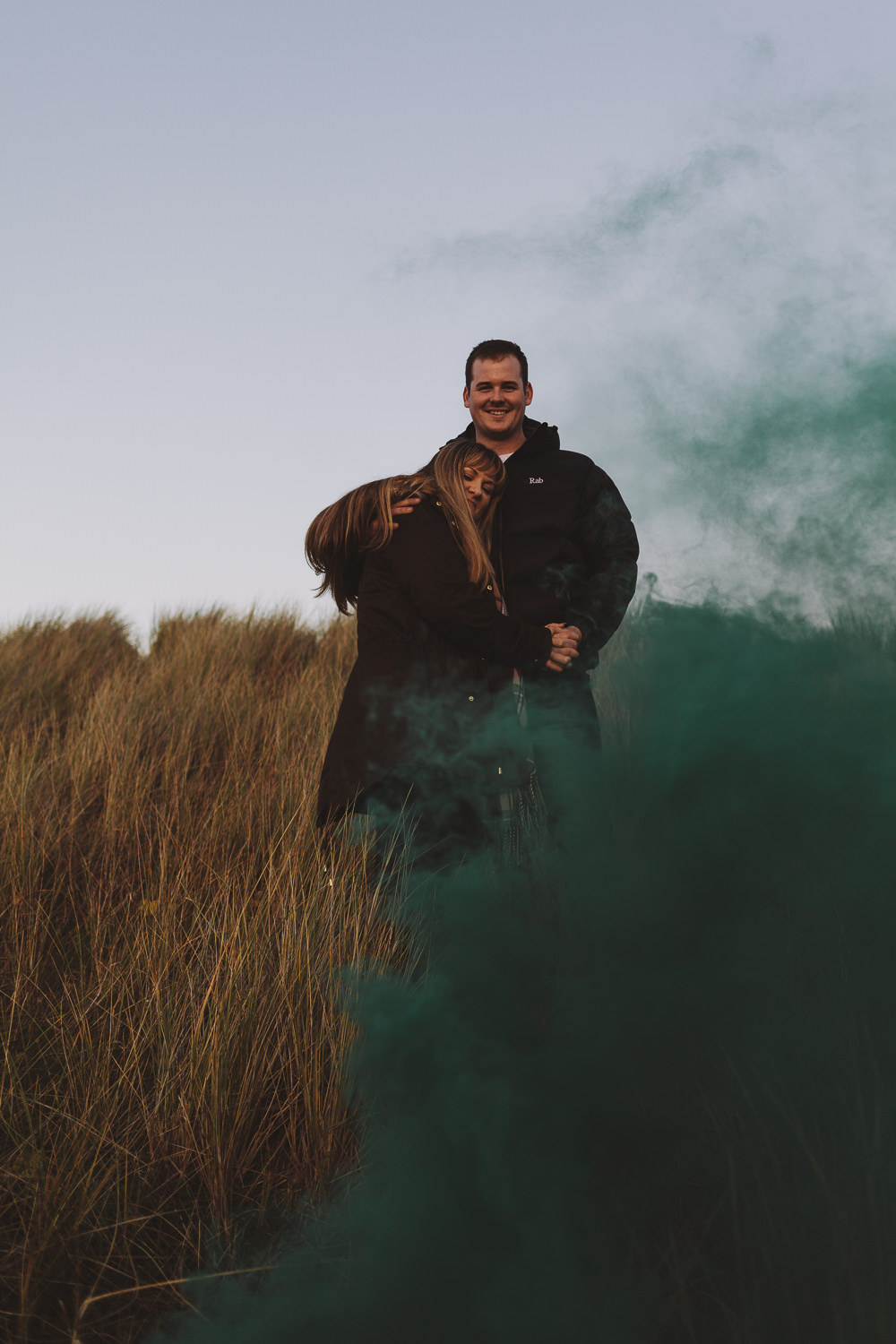 Callum and Dannielle with a green smoke bomb on Bamburgh Beach, Northumberland Coast,