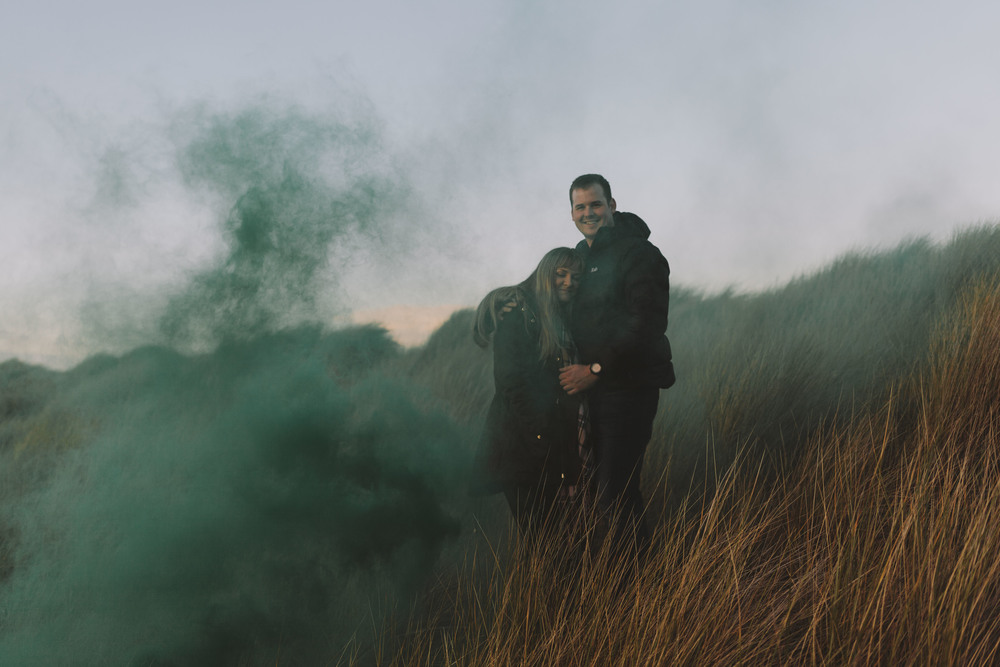 Northumberland engagement and wedding photographer Bamburgh Beach smoke bomb