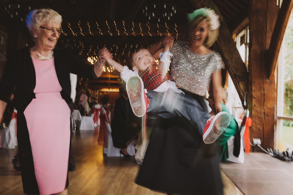 Carlisle Wedding Photographer // Child swinging on dancefloor