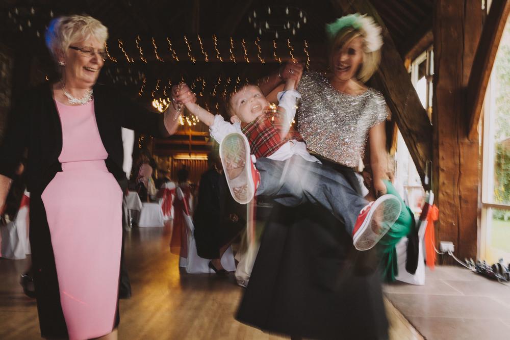 Carlisle Wedding Photographer // Child swinging on dancefloor