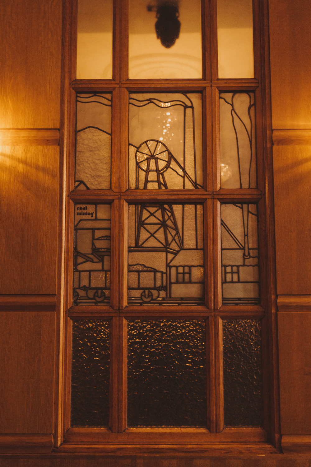 Oak panelling and art deco window in The Ballroom at The Vermont Hotel