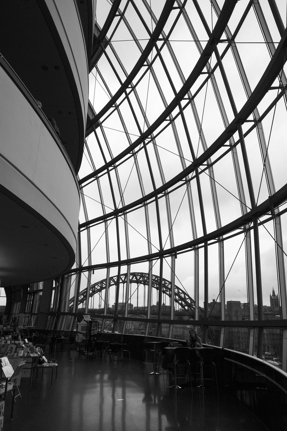 You can see the Tyne Bridge through the curved glass of the Sage Gateshead