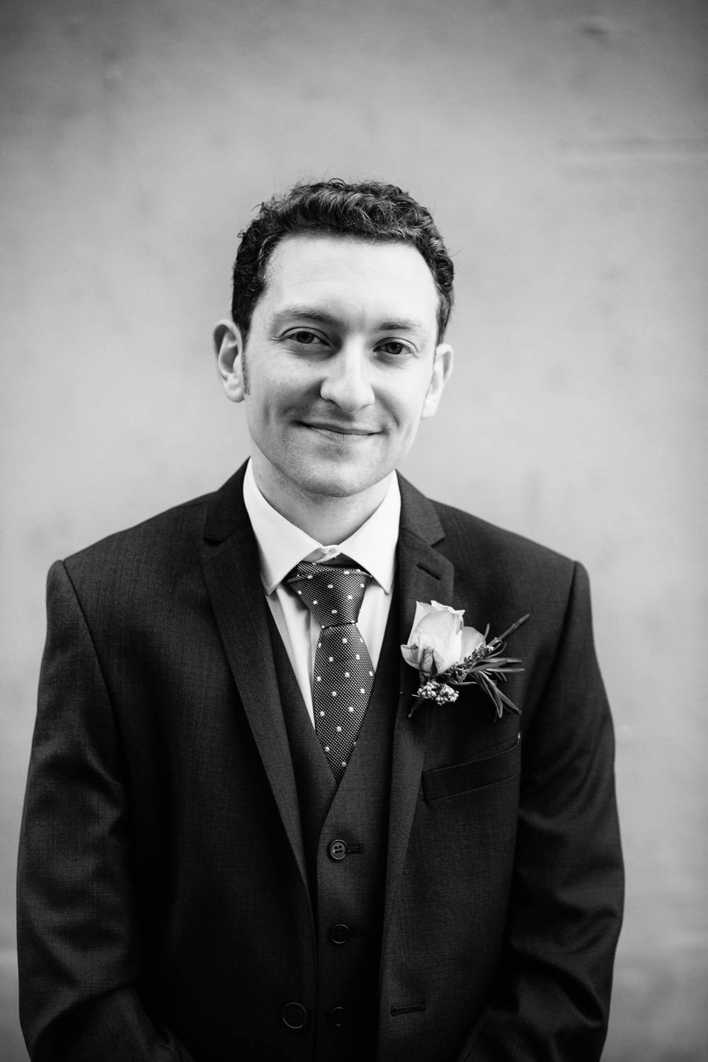 A simple and direct black and white portrait of the groom outside the Malmaison, Newcastle upon Tyne