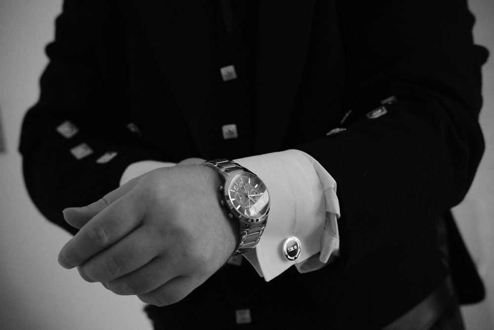 Newcastle Wedding Photographer // Groom putting on watch before wedding