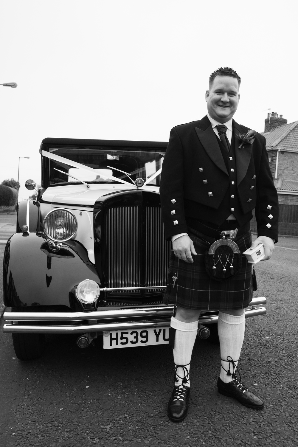 Newcastle Wedding Photographer // Groom posing in front of wedding car