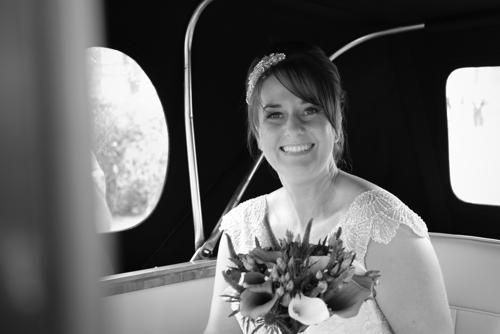 Newcastle Wedding Photographer // Bride in car on the way to the wedding