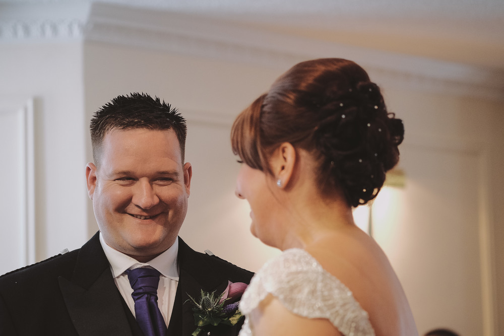 Newcastle Wedding Photographer // Bride and groom laughing during ceremony