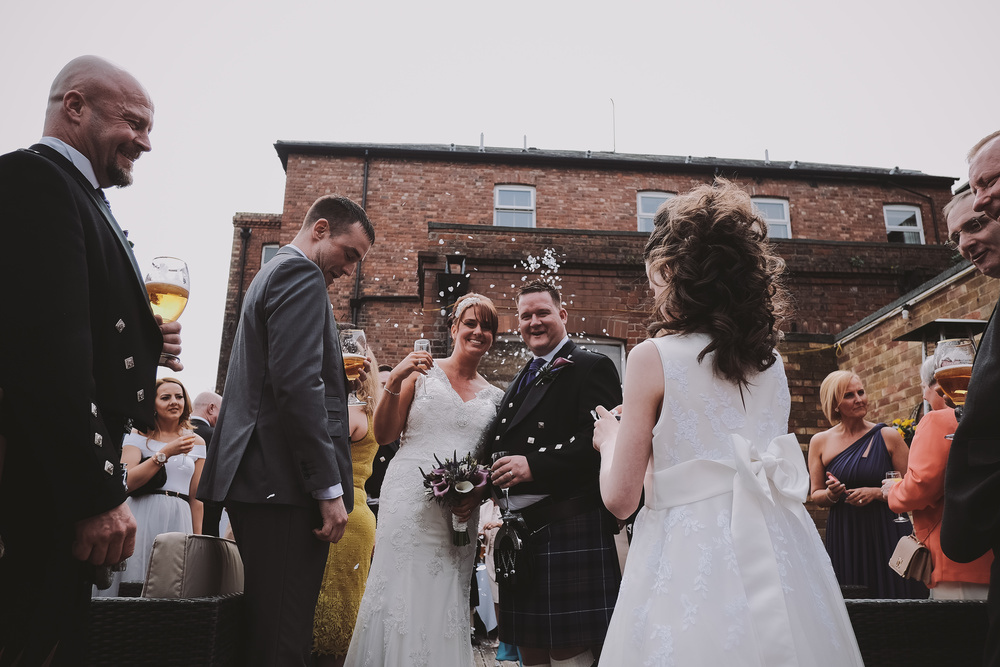 Newcastle Wedding Photographer // Bride and groom showered in confetti