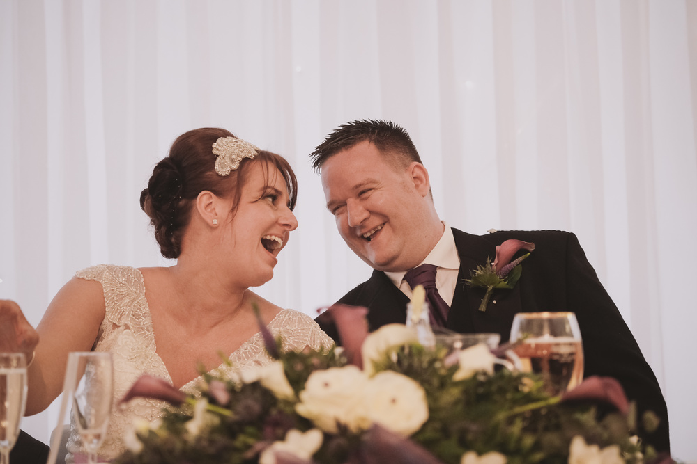 Newcastle Wedding Photographer // Bride and groom laugh during speeches