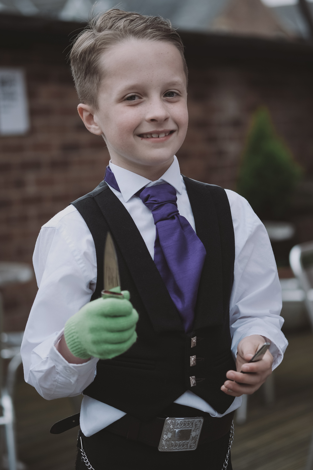 Newcastle Wedding Photographer // Page boy poses with knife