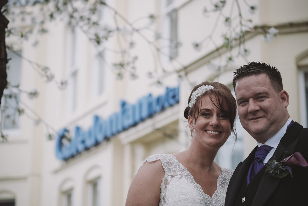 Newcastle Wedding Photographer // Close up of bride and groom outside Caledonian Hotel