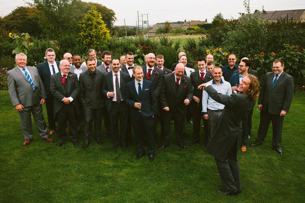 The Groom shows his ring to the rest of the male wedding party at South Causey Inn, Durham, photographed by Barry Forshaw